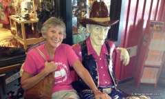 Debbie and her cowboy buddy at Wall Drug